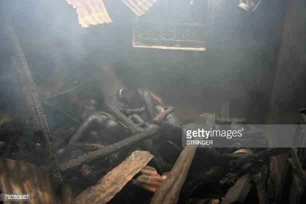 The charred bodies of at least ten people of Luo background lay under debris in a burnt house after taking refuge inside in to escape from Kikuyu...