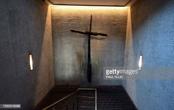 The Charred Cross in Coventry Cathedral in Coventry central England on February 12 made from two medieval roof beams which had fallen in the shape of...