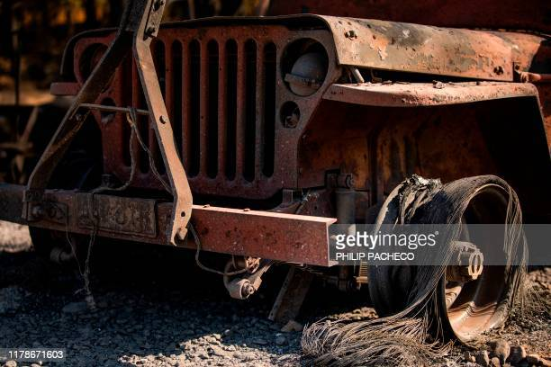 The charred remains of a vehicle sits on a property burned during the Kincade Fire along Highway 128 at in Healdsburg California on October 28 2019...
