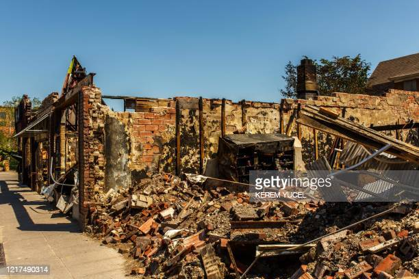 The charred wreckage of a building destroyed during last week's rioting which was sparked by the death of George Floyd on June 3, 2020 in...