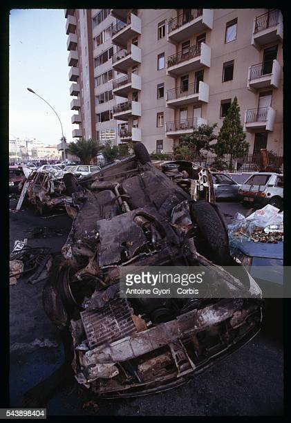 The charred wreckage of cars outside an apartment building attests to the force of the bomb that killed antiMafia judge Paolo Borsellino and his...