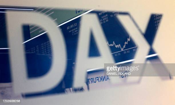 The chart of Germany's share index DAX reflects in the index' logo at the stock exchange in Frankfurt am Main western Germany on February 28 2020...