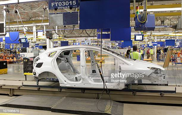 The chassis for a new 2012 Ford Motor Co Focus sedan sits on the production line at the company's Michigan Assembly Plant in Wayne Michigan US on...