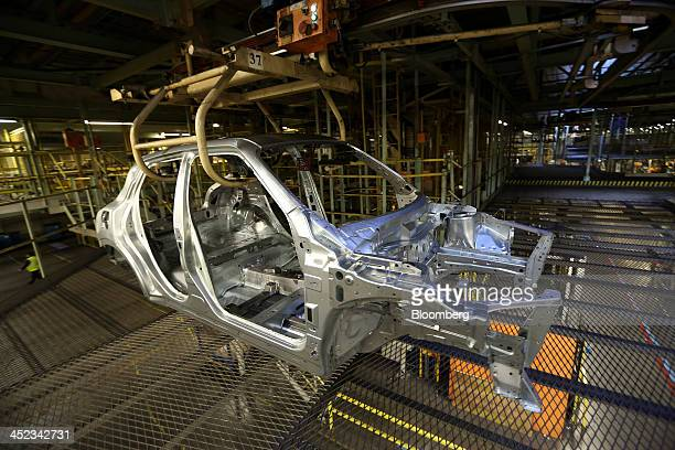 The chassis of a Nissan Juke automobile manufactured by Nissan Motor Co is transported through the bodyshop at the company's plant in Sunderland UK...