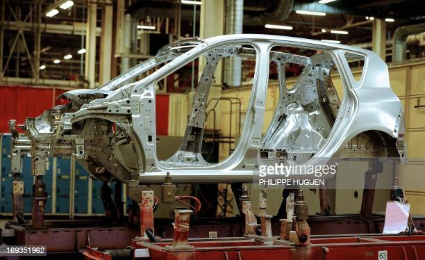 The chassis of a Scenic car is seen on an assembly line at the French carmaker Renault's plant in the northern city of Douai on May 23 2013 The...