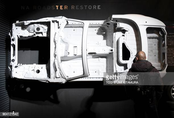 The chassis of the first generation Mazda Roadster known as MX5 Miata in the overseas market is displayed at the Mazda booth's restore section of the...