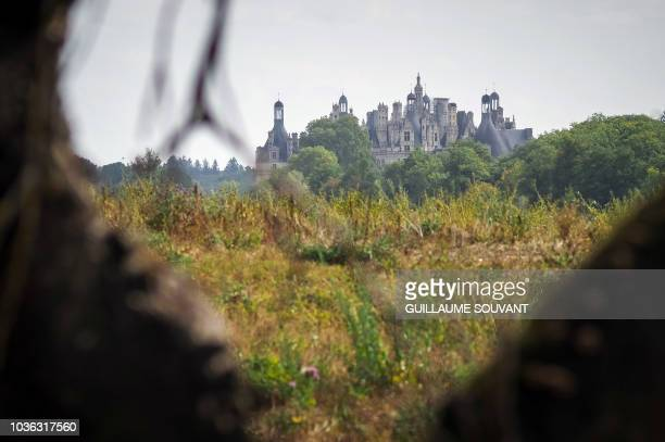 The Chateau de Chambord is seen through its vineyards on September 19 2018 Between 1518 and 1519 François Ier brought 80 000 feet of grape from...