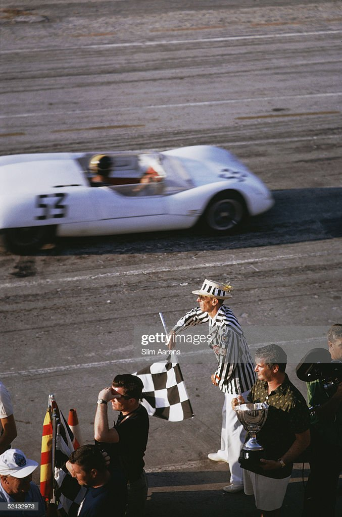 The checkered flag signals the end of the race during the 1963 Nassau Speed Week.