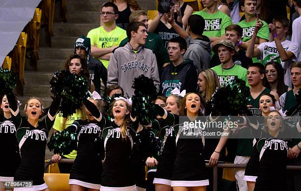 The cheer squad for Fossil Ridge leads their fans in a cheer The Regis Jesuit Raiders take on the Fossil Ridge Sabercats in the Colorado 5A High...