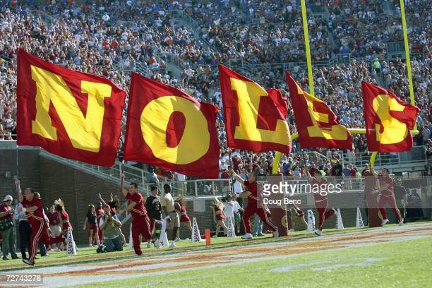 The cheer squad of the Florida State Seminoles carry banners before the game against the Florida Gators at Doak Campbell Stadium November 25 2006 in...