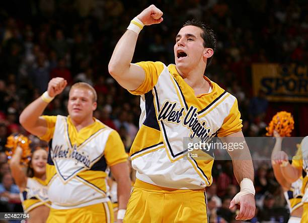 The cheerleaders for the West Virginia Mountaineers lead a cheer during a break in the action against the Louisville Cardinals in the Elite 8 game of...
