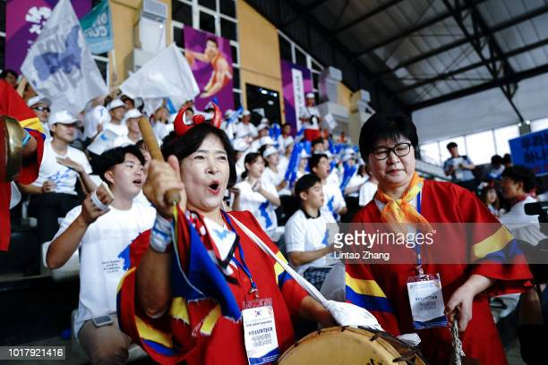 The Cheerleaders from The Korea cheer on their athletes during the Basketball Women's 5x5 match between North Korean and Korean mixed athletes and...