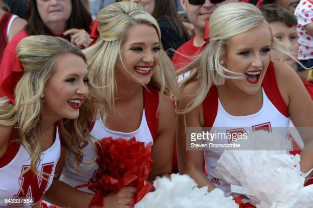 The cheerleaders of the Nebraska Cornhuskers perform before the arrival of the team in the game against the Arkansas State Red Wolves at Memorial...