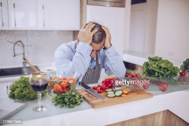 the chef is worried - overworked stock pictures, royalty-free photos & images