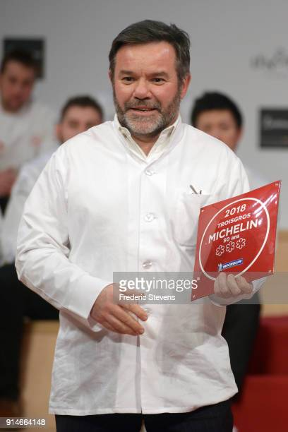 The chef Michel Troigros poses with his plaque representing 50 years of presence in the Michelin guide with his three stars during the Michelin Award...