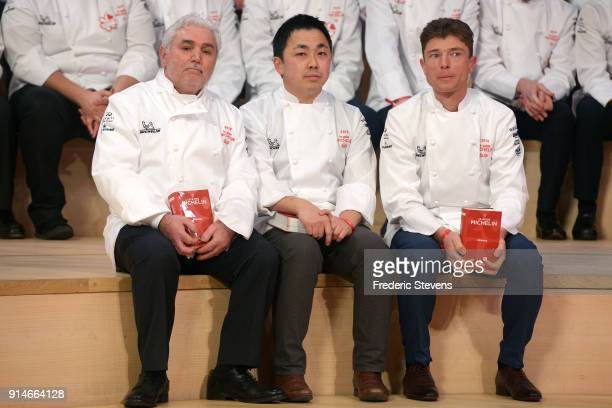 The chefs Bruno Cirino Masafumi Hamano and Jean Sulpice distinguished with two stars pose with the Michelin guide during the Michelin Award Ceremony...