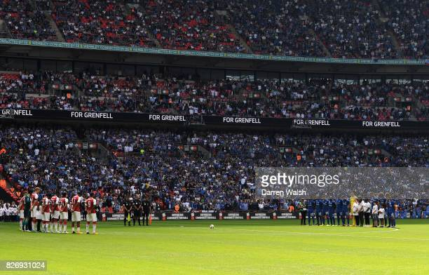 The Chelsea and Arsenal teams take part in a minute of silence in memory of the Grenfell Tower victims prior to the The FA Community Shield final...