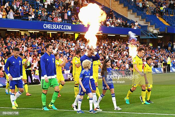 The Chelsea and Bristol Rovers teams walk out onto the pitch during the EFL Cup second round match between Chelsea and Bristol Rovers at Stamford...