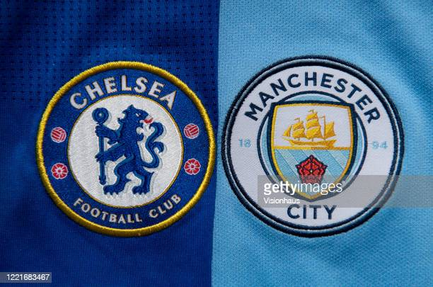 The Chelsea and Manchester City club crests on first team home shirts on April 27 2020 in Manchester England