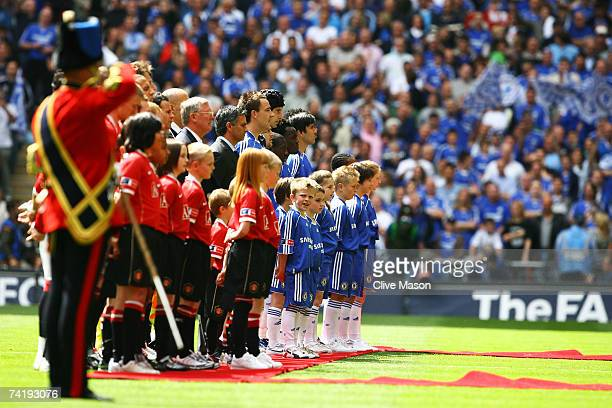 The Chelsea and Manchester United teams line up prior to the FA Cup Final match sponsored by E.ON between Manchester United and Chelsea at Wembley...