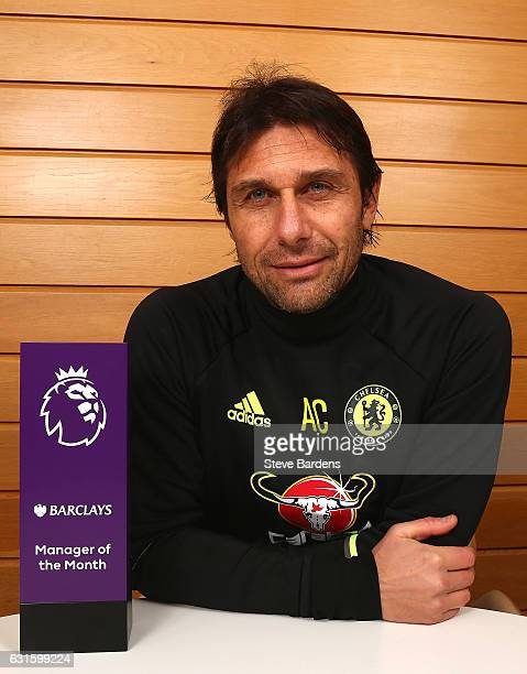 The Chelsea Manager Antonio Conte poses with the Premier League Manager of the Month Award for December 2016 at Chelsea Training Ground on January 12...