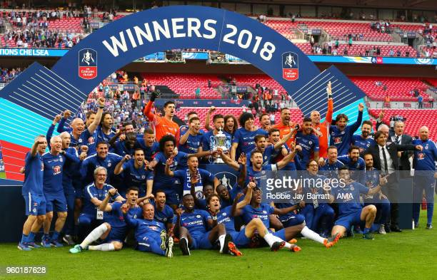 The Chelsea players and staff celebrate with the trophy at the end of the Emirates FA Cup Final between Chelsea and Manchester United at Wembley...