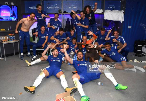 The Chelsea players celebrate winning the Emirates FA Cup trophy in the dressing room after The Emirates FA Cup Final between Chelsea and Manchester...