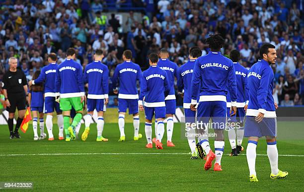 The Chelsea side walk out onto pitch as Pedro of Chelsea looks on during the EFL Cup second round match between Chelsea and Bristol Rovers at...