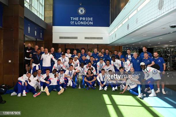 The Chelsea squad pose for a photo after arriving back at the Chelsea Training Ground following yesterday's victory in the UEFA Champions League...