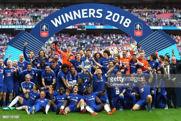 The Chelsea team and staff pose with the Emirates FA Cup trophy following their victory during The Emirates FA Cup Final between Chelsea and...