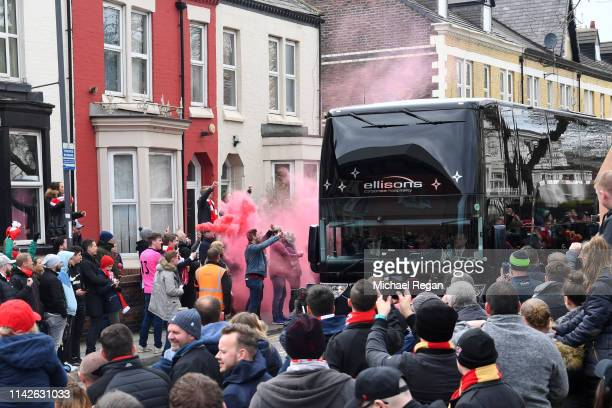 The Chelsea team bus is welcomed by fans prior to the Premier League match between Liverpool FC and Chelsea FC at Anfield on April 14 2019 in...