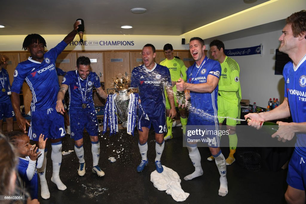 The Chelsea team celebrate inside the changing room after the Premier League match between Chelsea and Sunderland at Stamford Bridge on May 21, 2017 in London, England.