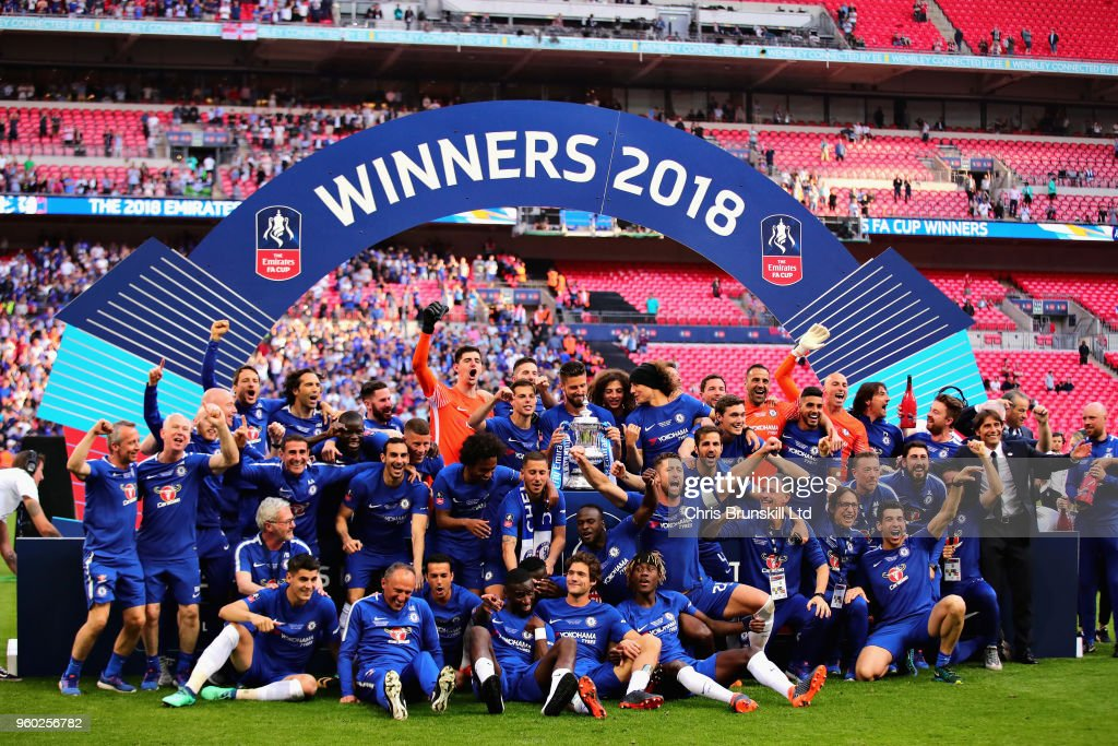 The Chelsea team celebrate victory with the trophy after the Emirates FA Cup Final between Chelsea and Manchester United at Wembley Stadium on May 19, 2018 in London, England.