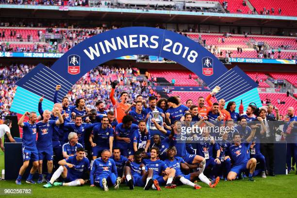 The Chelsea team celebrate victory with the trophy after the Emirates FA Cup Final between Chelsea and Manchester United at Wembley Stadium on May 19...