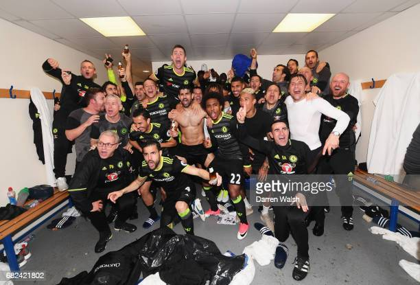 The Chelsea team celebrate winning the leauge in the changing room after the Premier League match between West Bromwich Albion and Chelsea at The...
