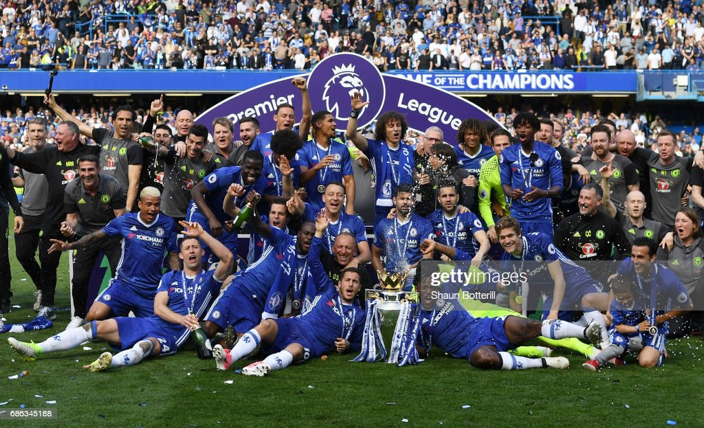 The Chelsea team celebrate with the Premier League Trophy after the Premier League match between Chelsea and Sunderland at Stamford Bridge on May 21, 2017 in London, England.