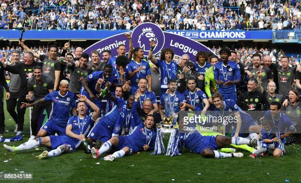 The Chelsea team celebrate with the Premier League Trophy after the Premier League match between Chelsea and Sunderland at Stamford Bridge on May 21...