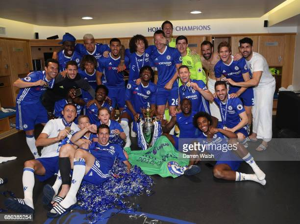 The Chelsea Team Celebrate With Premier League Trophy In Changing Room After