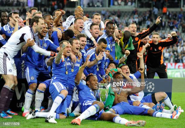The Chelsea team celebrate with the trophy after the UEFA Champions League Final between FC Bayern Munich and Chelsea at the Fussball Arena Munich on...