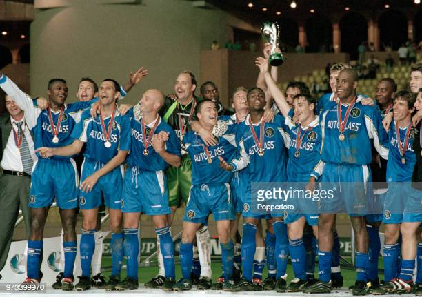 The Chelsea team celebrate with the trophy after the UEFA Super Cup Final between Real Madrid and Chelsea at the Stade Louis II on August 28 1998 in...