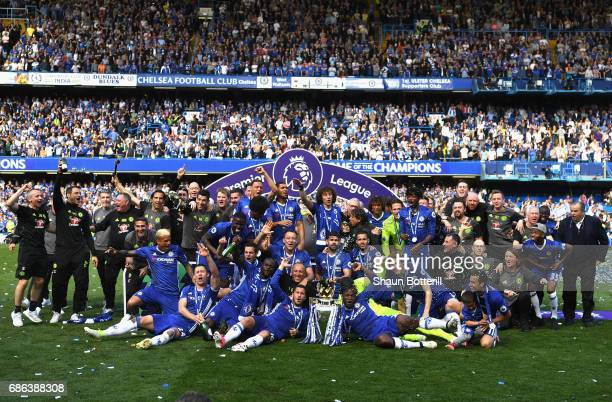 The Chelsea team pose with the Premier League Trophy after the Premier League match between Chelsea and Sunderland at Stamford Bridge on May 21 2017...