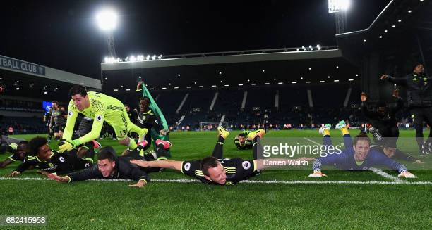 The Chelsea team slide on the pitch while celebrating winning the leauge after the Premier League match between West Bromwich Albion and Chelsea at...