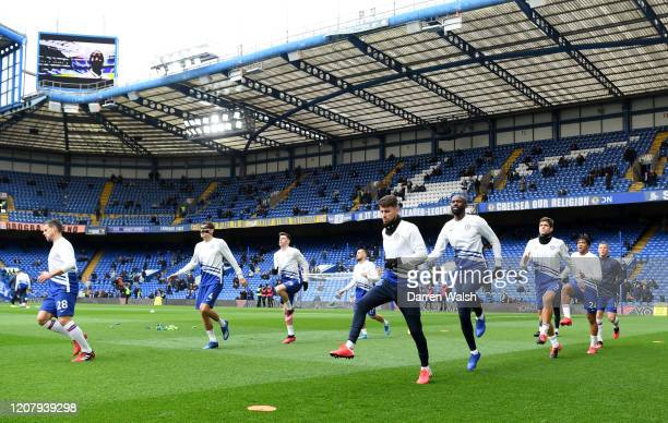 The Chelsea team warm up during the Premier League match between Chelsea FC and Tottenham Hotspur at Stamford Bridge on February 22 2020 in London...