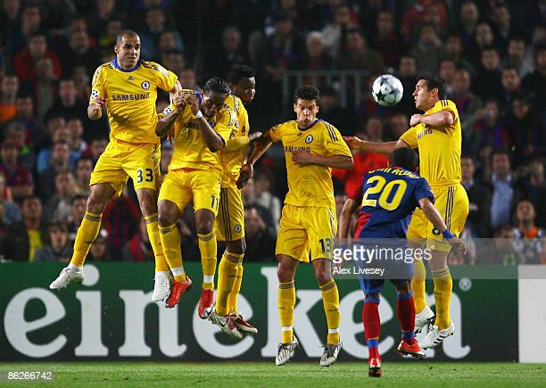 The Chelsea wall with Alex Didier Drogba John Mikel Obi Michael Ballack and Frank Lampard defend a free kick from Daniel Alves of Barcelona during...
