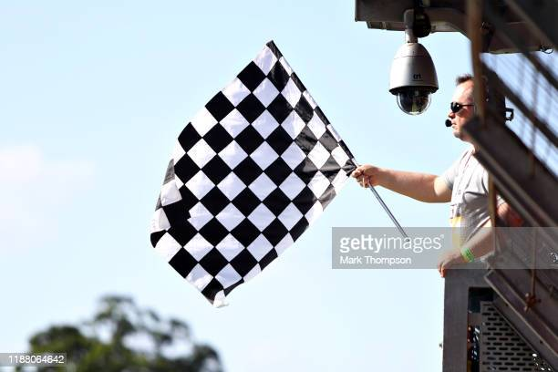 The chequered flag is waved during qualifying for the F1 Grand Prix of Brazil at Autodromo Jose Carlos Pace on November 16 2019 in Sao Paulo Brazil