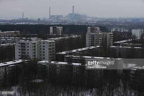 The Chernobyl Power Plant is seen in the distance as the abandoned town of Pripyat stretches out in the foreground on January 25, 2006 near...