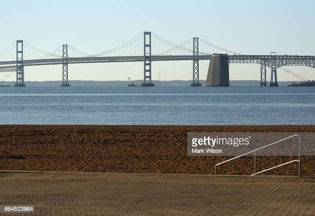 The Chesapeake Bay Bridge can be seen from the beach at Sandy Point State Park on March 17 2017 in Skidmore Maryland Under US President Donald...