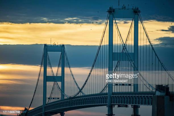 The Chesapeake Bay Bridge is seen at sunset on May 2, 2020 in Stevensville, Maryland. - The Chesapeake Bay Bridge is a major dual-span bridge in the...