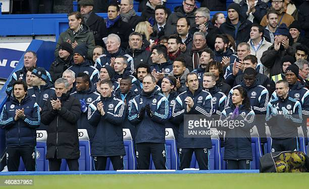 The Cheslea bench applaud in memory of the WWI truce ahead of the English Premier League football match between Chelsea and West Ham United at...