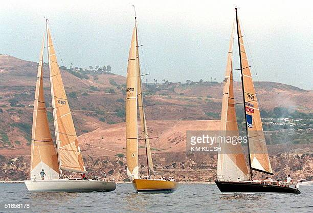 The Cheval Taxi Dancer and Ragtime yachts pass the start line together in the Transpac '97 yacht race for Division 1 and 2 entrants 05 July off the...
